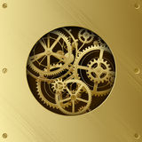 Metallic gear wheels in the brass plate with cut round hole Stock Photos
