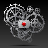 Metallic gear wheels of clockwork with start and stop red button Royalty Free Stock Photo