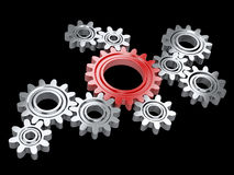 Metallic gears and one red. Teamwork and leadership concept. Stock Image