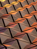 Metallic geometric cladding or panels in copper and gold colours Stock Photo