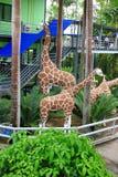 Metallic giraffe statue in garden Royalty Free Stock Photography