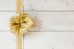 Metallic gold decorative Christmas bow Royalty Free Stock Photography