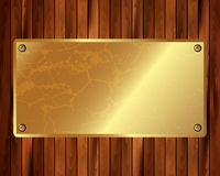 Metallic gold frame on a wooden background 10 Royalty Free Stock Photo