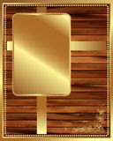 Metallic gold frame on a wooden background 3 Stock Image