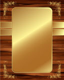 Metallic gold frame on a wooden background 4 Stock Photo