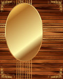 Metallic gold frame on a wooden background 6 Stock Photo