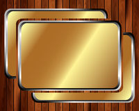 Metallic gold frame on a wooden background 2 Royalty Free Stock Photo