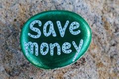 Metallic green painted rock states Save Money Stock Images