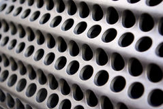 Metallic grid. Background of wavy metallic grid with holes royalty free stock photos