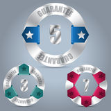 Metallic guarantee badge set with color ribbons. Metallic guarantee badge set of three with various color ribbons Stock Photography