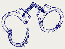 Metallic handcuffs Stock Photography