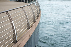 Metallic handrails deck. Water edge with deck protected by modern metallic handrails stock image