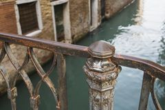 Metallic handrails fragment. Old metallic handrails fragment over channel waters in Venice Stock Photo