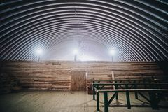 Metallic hangar roof. Hangar and wooden fence and lamps Royalty Free Stock Images