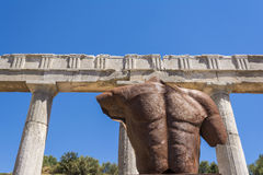 Metallic headless statue in the ancient Greek city of Messinia, Greece. Metallic headless statue in the ancient Greek city of Messinia at Peloponnese, Greece Royalty Free Stock Images