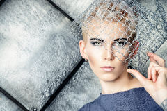 Metallic headwear. Avant-garde. Fashionable designer collection with the use of metal wire over grunge background. Urban style. Futurism stock photos