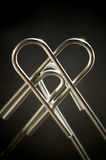 Metallic heart. Done with two paper clips Royalty Free Stock Photography