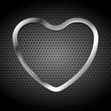 Metallic heart on perforated background Royalty Free Stock Photo