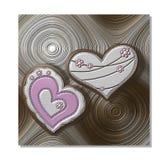 Metallic hearts on textured circular background Stock Image