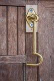Metallic hook on a closet Stock Photography
