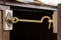 Metallic hook on a closet Stock Image