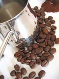 Metallic ibrik, coffee beans. Metallic ibrik with reflected coffee beans and ground coffee royalty free stock image