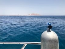 Metallic, iron, shiny chrome-plated stainless oxygen tank, diving equipment onboard the box, boat, cruise liner against the blue s. Ea, ocean stock photos