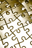 Metallic jigsaw puzzle pieces Stock Photography