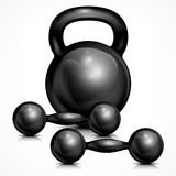 Metallic kettle bell and two dumbbells Royalty Free Stock Photos