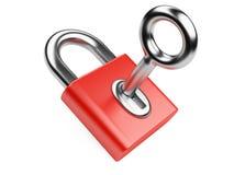 Metallic key in red padlock Stock Image