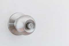 Metallic knob on white door Royalty Free Stock Images