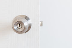 Metallic knob on white door Royalty Free Stock Image