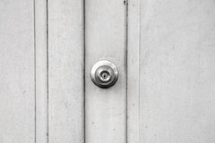 Metallic knob on white wood door , stainless steel round ball door knob Royalty Free Stock Photography