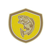 Metallic Largemouth Bass Jumping Shield Retro. Metallic styled illustration of a largemouth bass fish jumping inside a shield crest done in retro style Royalty Free Stock Image