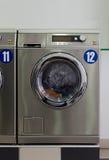 Metallic laundromat Stock Images