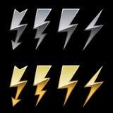 Metallic lightning icons. Chrome and golden lightning icons isolated on black background Stock Image