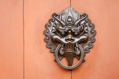 Metallic Lion statue door lock Stock Photos