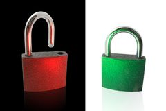 Metallic lock and unlock. Metallic green lock over white and red unlock over black royalty free stock image
