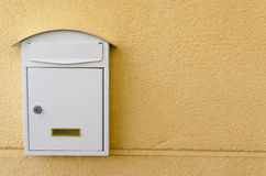 Metallic mailbox in white Stock Photo