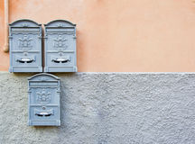 Metallic mailboxes in gray placed on the house wall Royalty Free Stock Photography