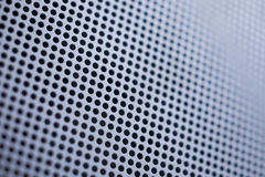 Metallic Mesh Background. Blue tones metallic mesh patterned background. Shallow depth of field Stock Images