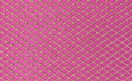 Metallic mesh on pink background Royalty Free Stock Photos