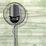Metallic microphone. Abstract musical template with retro style metallic microphone and butterflies Royalty Free Stock Photography