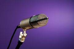Metallic microphone on purple Stock Photo