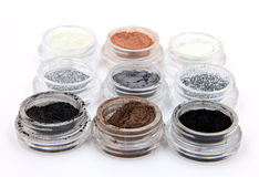 Metallic Mineral Powder Cosmetics. Metallic and glitter powerder mineral cosmetics isolated on white Royalty Free Stock Image