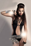 Metallic Model. High fashion capture of gorgeous model in tiny body with metallic effects stock image