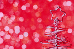 Metallic modern christmas tree on red tint light bokeh background, xmas holiday Stock Photography
