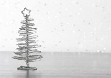 Metallic modern christmas tree on wood table Stock Images