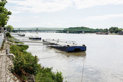 Metallic mooring for boats and bridge over the Danube River in B Stock Photo