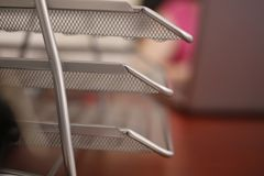 Metallic multilevel office document tray. Archival stock photos